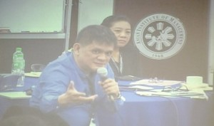 Norelyn (back) intently listens to Media Contacts Philippines CEO Ed Mapa (foreground) answering delegates' questions
